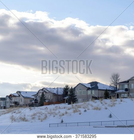 Square Crop Clouds And Blue Sky Over Homes On Pristine Terrain Of Wasatch Mountains