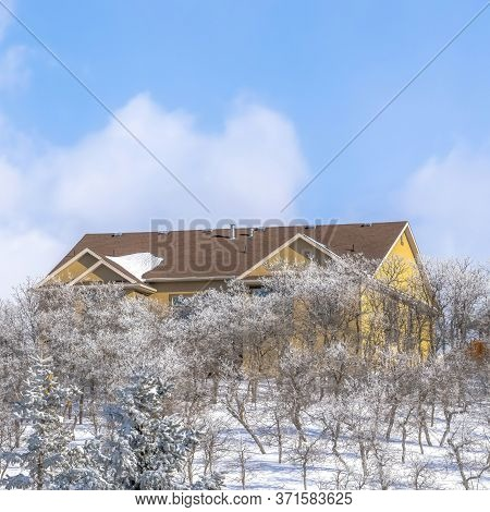 Square Frame Pristine Terrain Of Wasatch Mountains With Homes Amidst Fresh Snow In Winter