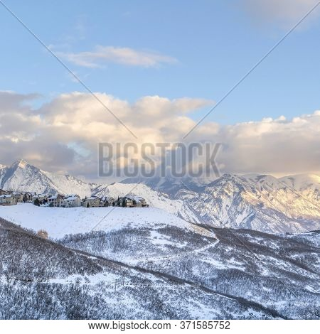 Square Panoramic View Of Homes Situated Amidst Striking Wasatch Mountains In Winter