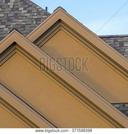 Square House Exterior With Front Gable Roof Design Against Blue Sky Background