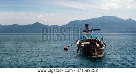 Oceanside Lanscape View From Phuket Thailand With Fisherman Wood Boat To Fishing. Panorama Banner Si