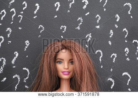 Tambov, Russian Federation - June 14, 2020 Portrait Of Barbie Doll With Brown Hair Against Blackboar