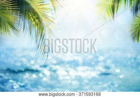 Blurred Blue Sky And Sea With Bokeh Light And Leaves Palm Tree - Summer Vacation Concept