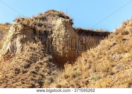 Mountain Landslide In An Environmentally Hazardous Area. Large Cracks In Earth, Descent Of Large Lay
