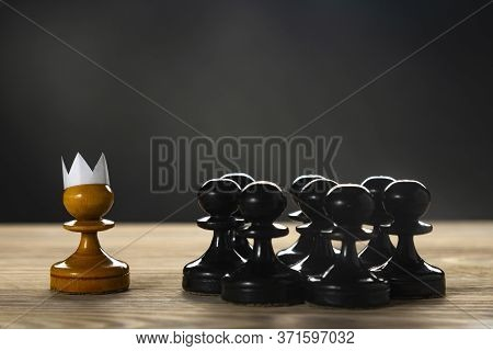 Small Courageous Pawn With An Artificial Paper Crown Suit, Leading Others Into Battle With The Enemy