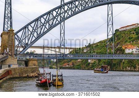 View Across The Douro River And Dom Luis I Bridge In Vila Nova De Gaia And Rabelo Boats That Were Us