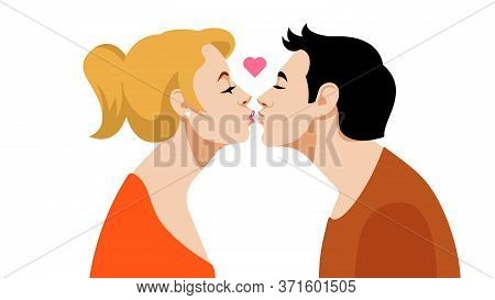 Kiss. A Young Guy Kisses A Young Pretty Girl. Brunette Guy And Blonde Girl. The Concept Of The First