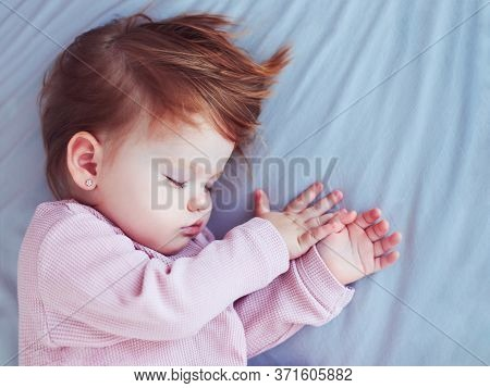 Beautiful Redhead Baby Girl Sleeping Peacefully In The Bed