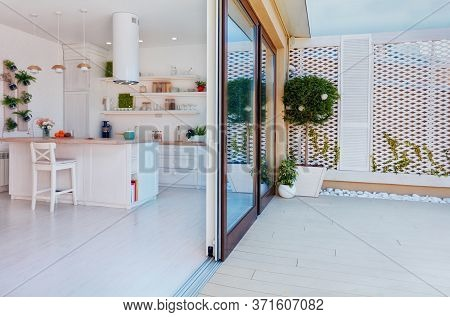 Open Space Kitchen With Sliding Doors And Rooftop Patio Zone