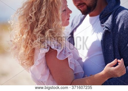 Defocused Young Adult Couple At Summer Day. Curly, Blonde Woman And Bearded Man