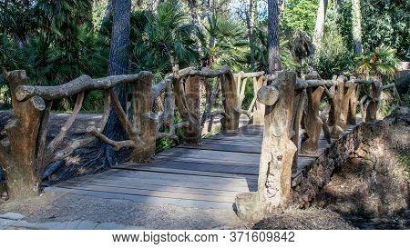 Openwork Wooden Footbridge In The Natural Park In Spring.