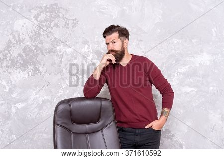 Need Some Inspiration For Office Wardrobe. Serious Hipster Stand At Chair. Bearded Man Wear Casual S