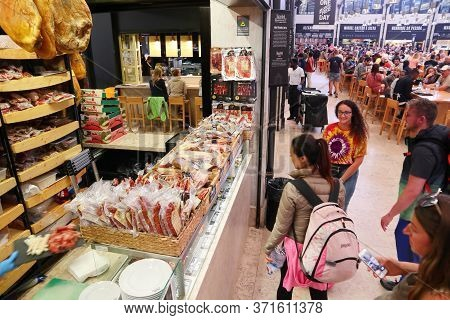 Lisbon, Portugal - June 6, 2018: People Visit Traditional Butcher Store At Timeout Market In Lisbon,