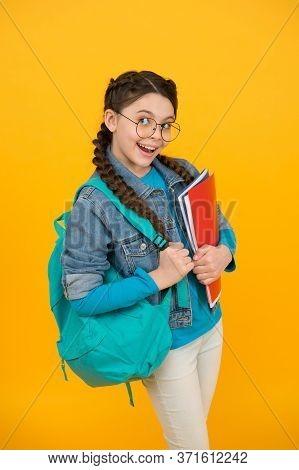 Got Homework Done. Playful Girl Hold School Bag And Books. Homework Assignment. Home Schooling. Home