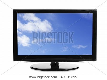Modern Plasma Tv With Skyscape On Screen Against White Background