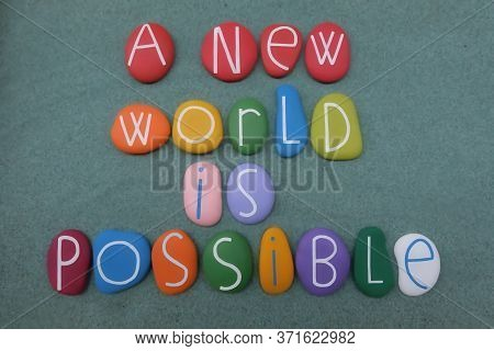 A New World Is Possible, Environmental And Motivational Slogan Composed With Multi Colored Stone Let