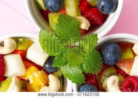 Fresh Fruit Salad On White Bowl. Mixed Fruit In White Bowl Healthy Food Style. Useful Fruit Salad Of