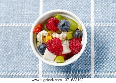 Fresh Fruit Salad On White Bowl. Mixed Fruit In White Bowl Healthy Food Style. Useful Fruit Salad Of