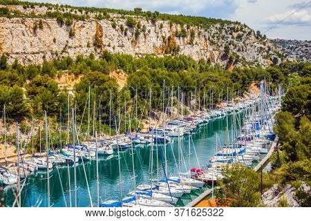 Calanques are the attractions of Provence. France. Picturesque bays of the Cote d'Azur. Sailing yachts on the azure water of the south fjord.  The concept of active, eco-friendly tourism