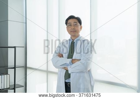 Portrait Of Happy Smiling Thai Asian Senior Doctor, Man Person Working At Hospital In Medical And Co