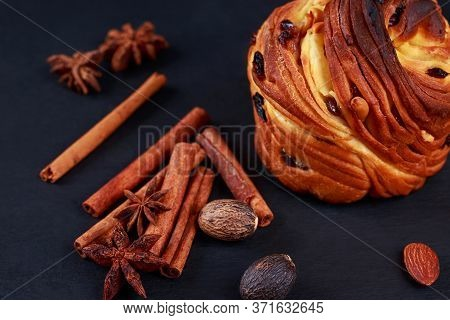 Large Kraffin With Raisins And Cinnamon Sticks On A Gray Background