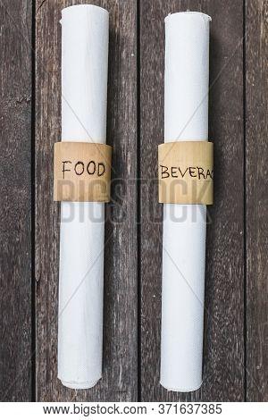 Unusual Menu Folded Into A Bundle. White Menu Restaurant On Wooden Background