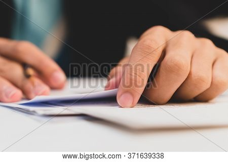Businessman Hands Working In Stacks Of Paper Files For Searching Information On Work Desk Office, Bu