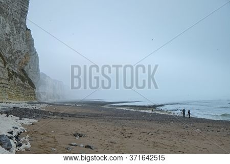 Misty Morning Landscape Of The Natural White Chalk Cliffs In Etretat, Normandy, France, La Manche Or