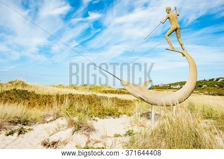 Martha's Vineyard Usa - October 16 2014; Harpooner Sculpture On Martha's Vineyard New England By Scu