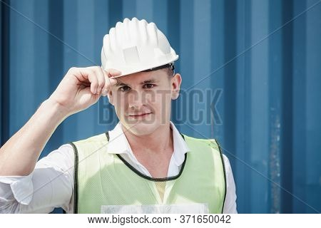 Portrait Confident Transport Engineer Man In Safety Equipment Standing In Container Ship Yard. Trans