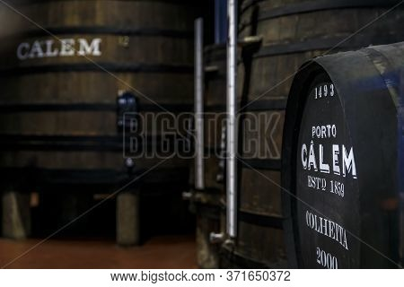 Porto, Portugal - May 31, 2018: Stored Branded Barrels Of Port Wine On Display At Calem Cellar, Popu