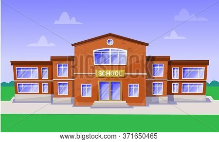 Big School With Green Territory Schoolyard For Outdoor Lessons And Playing Games. Red Building For P