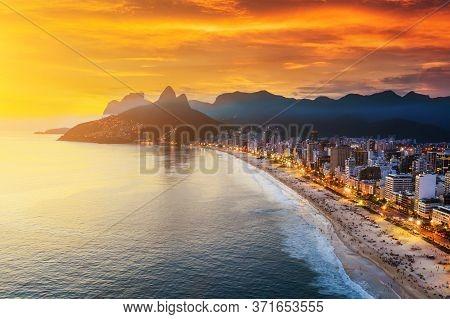 Beautiful Panorama Of Rio De Janeiro At Twilight, Brazil. Aerial View Of Ipanema Beach At Sunset. Ri