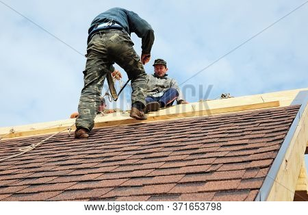 Kyiv, Ukraine - June, 23, 2020:roofing Contractors With Safety Ropes, Fall Protection Are Finishing