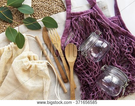 Cotton Bags, Net Bag With Reusable  Glass Jars And Bamboo Cutlery. Zero Waste Concept. Eco Friendly.