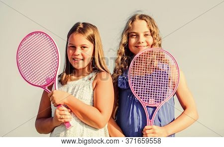 Rest Time. Sporty Game Playing. Summer Outdoor Games. Play Tennis. Childhood Happiness And Sisterhoo