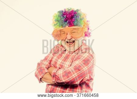 Elderly Clown. Man Senior Bearded Cheerful Person Wear Colorful Wig And Sunglasses. Having Fun. Funn