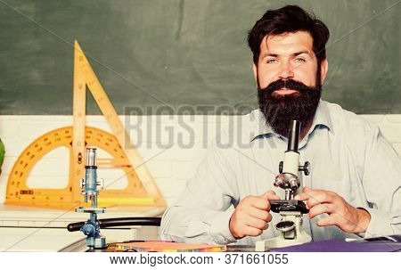 Fascinating Research. Set Up Microscope. Teacher Sit Desk With Microscope. Man Bearded Hipster Class