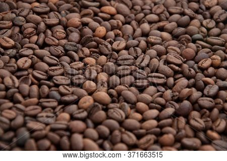 Roasted Coffee Beans Background. Arabica Pure Blend