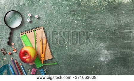 School Background Green Chalkboard And Stationery School Tools