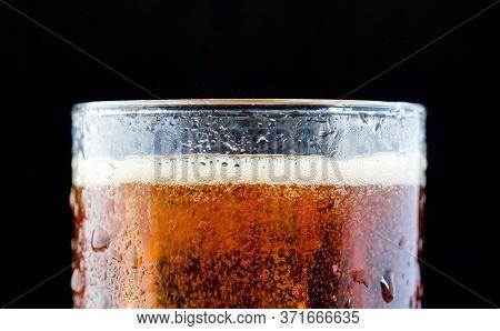 ice cube in fizzy splashing water with soda bubble