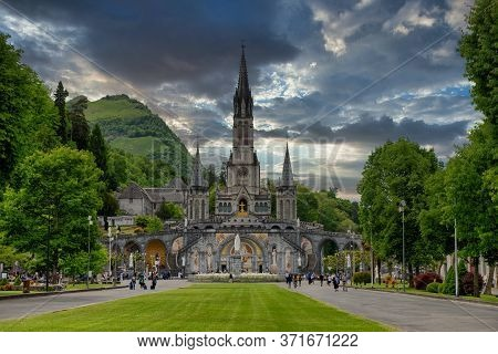 A View Of The Basilica Of Lourdes In France