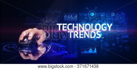 hand holding wireless peripheral with TECHNOLOGY TRENDS inscription, modern technology concept