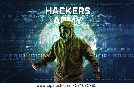 Faceless hacker at work with HACKERS ARMY inscription, Computer security concept