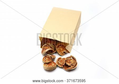 Dry Bale Fruit. Healthy Drinking Of Organic Fruit. Bale Fruit In Paper Bag Isolated On White Backgro