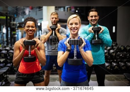 Group Of Sportive People In Gym. Happy Fit Friends Workout, Exercise In Fitness Club