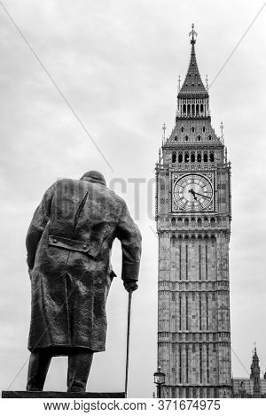 London, UK - 5th June 2017: Statue of the wartime British Prime Minister Winston Churchill, with the tower of Big Ben in the background. Parliament square, City of Westminster.