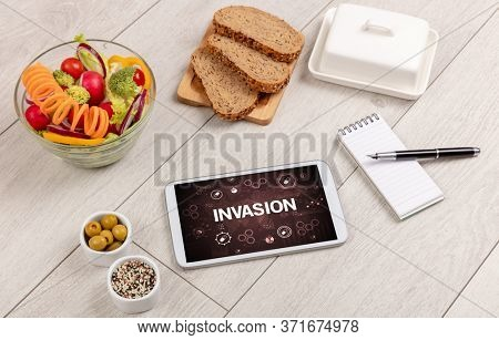 Healthy Tablet Pc compostion with INVASION inscription, immune system boost concept