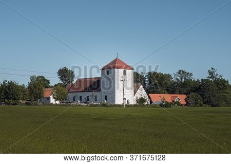 The Medieval Fulltofta Church Stand Close To The Agricultural Fields In The Flat Farmlands Of Skåne