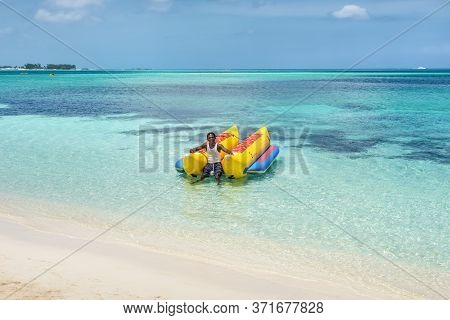 Nassau, Bahamas - May 3, 2019: Banana Boat On The Goodman's  Beach In Nassau, Bahamas. Inflatable Ba